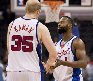 Job well done. Chris Kaman has some kind words for Baron Davis after the Clippers lock up the win. (AP)