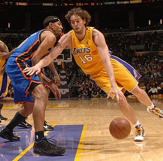 Paul Gasol, who scores 11 points and grabs 16 rebounds, drives to the hoop.  (Getty Images)