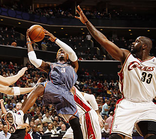 Gerald Wallace (31 points, 14 boards) creates all sorts of problems for Shaq and the Cavs.  (Getty Images)