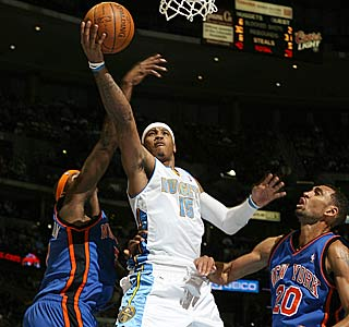 Carmelo Anthony adds to his NBA scoring lead, dropping a career-high 50.  (Getty Images)