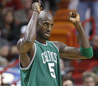 Kevin Garnett nails 11 of his 12 attempts from the field, including some critical shots late.  (AP)