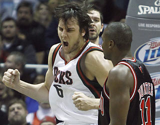 Andrew Bogut returns to the Bucks lineup ahead of schedule and provides 22 points and 15 rebounds.  (AP)