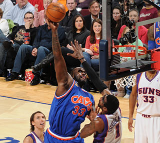 Shaq compiles 12 points and nine rebounds in just 21 minutes against his ex-team.  (Getty Images)