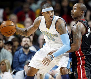 Carmelo Anthony struggles from the field (6 of 17) but still finishes with 22 points in the rout.  (AP)