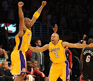 The celebration begins for Kobe (left) after knocking down the winning shot at the buzzer. (Getty Images)
