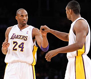 Kobe Bryant and Ron Artest celebrate as the Lakers improve to an NBA-best 16-3.  (Getty Images)