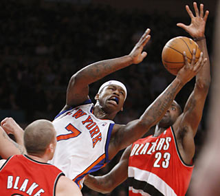 Al Harrington, one of five Knicks to score in double figures, provides 12 points and seven rebounds.  (AP)