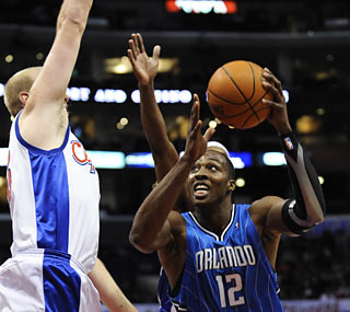 Dwight Howard has a dominant outing on his birthday as he provides 25 points and 11 boards.  (AP)
