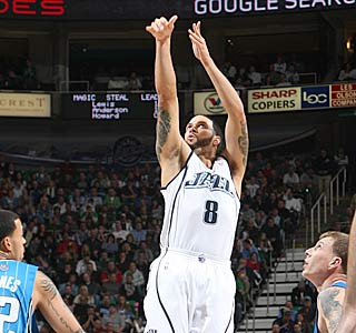 Deron Williams rises above the competition, finishing with 32 points and 15 assists.  (Getty Images)