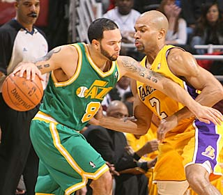 Deron Williams works hard for his 21 points and 11 assists as the Jazz trip up the Lakers.  (Getty Images)