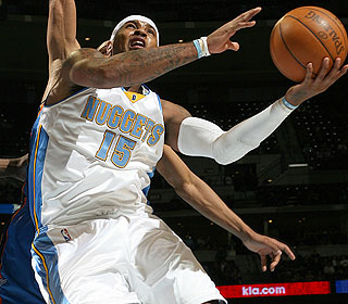 Carmelo Anthony scores more than 30 points again, going 12 of 22 from the field in the win. (Getty Images)