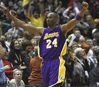 Kobe Bryant, who scores 27 of his 39 points after halftime, celebrates his game winner. (AP)