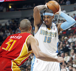 Shane Battier and the Rockets can do little to stop Carmelo Anthony, who ends with 38 points.  (AP)