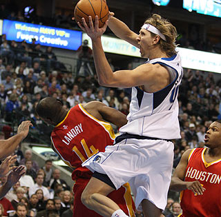 Carl Landry earns a trip to the ER and Dirk Nowitzki gets stitches after this collision.    (US Presswire)