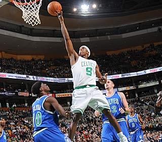 Rajon Rondo attacks the rim for two of his 13 points to go along with his 15 assists.  (Getty Images)