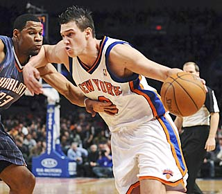 Danilo Gallinari shows he's more than just a spot-up shooter, driving on Stephen Graham.  (AP)
