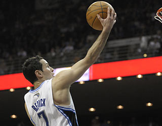 J.J. Redick comes off the bench and scores 20 points to help the Magic push past the Jazz.  (AP)