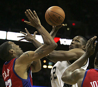Center Theo Ratliff provides 10 points and seven rebounds off the deep Spurs bench.  (AP)