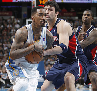 Zaza Pachulia and the Hawks are powerless to stop J.R. Smith, who drops a season-high 41 points.  (AP)