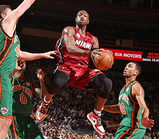 Dwyane Wade takes to the air against the Knicks, hitting 11 of 21 shots with 10 rebounds. (Getty Images)