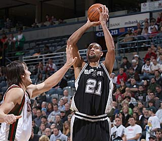 Tim Duncan picks apart the Bucks efficiently, hitting 11 of 16 shots to score 26 points.  (Getty Images)