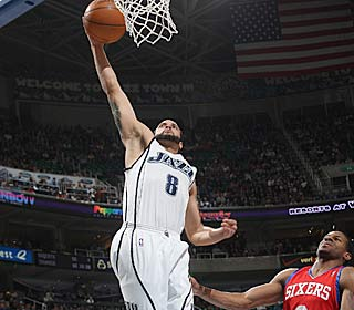 Deron Williams hits two of his 27 as the Jazz beat the Sixers for the sixth straight time.  (Getty Images)