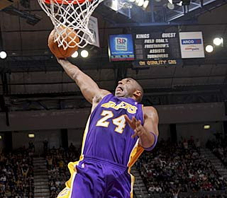 Kobe Bryant throws down two of his 38 as the Lakers rebound from their Christmas Day loss.  (Getty Images)