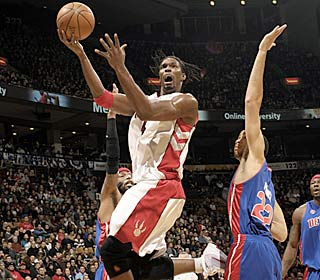 Chris Bosh puts the Raptors on his back, netting game highs with 25 points and 16 boards.  (Getty Images)