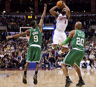 Double team won't do it against Baron Davis, who hits this shot over Rajon Rondo and Ray Allen. (AP)