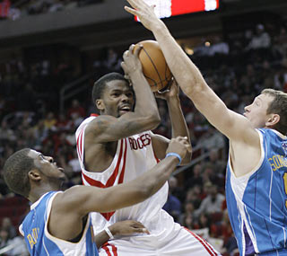 Aaron Brooks provides 27 points as the Rockets send the Hornets to 2-13 on the road this season.  (AP)