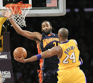 Kobe Bryant makes ex-Laker Ronny Turiaf and the rest of the Warriors pay by dropping 44 points.  (AP)