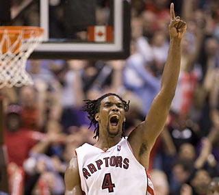 Chris Bosh (33 points, 13 rebounds) is ecstatic moments after his Raptors claw out a thrilling win.  (AP)