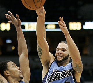 Deron Williams (21 points, 12 rebounds) makes sure Utah avoids another loss to Minnesota. (AP)