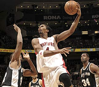 Chris Bosh nets 22 points and eclipses Vince Carter as the Raptors' all-time leading scorer.  (Getty Images)
