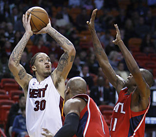 The Heat get a strong showing from Michael Beasley, who scores 20 of his 22 points in the first half.  (AP)