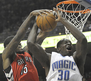 Amir Johnson and the Raptors deny Brandon Bass' Magic a win despite Orlando's 35-point fourth.  (AP)