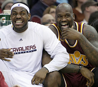 LeBron and Shaq have time to horse around on the bench as their Cavs throttle the hapless Wizards.  (AP)