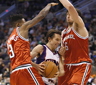 Despite climbing back from a 24-point hole, the Bucks allow Steve Nash's Suns to squeeze out the win.  (AP)