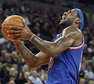 LeBron James (37 points, 11 assists) dominates and finishes two rebounds shy of a triple-double.  (AP)