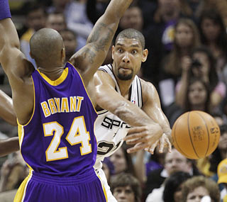Tim Duncan (25 points, 13 rebounds) helps the Spurs rout the defending champion Lakers.  (AP)