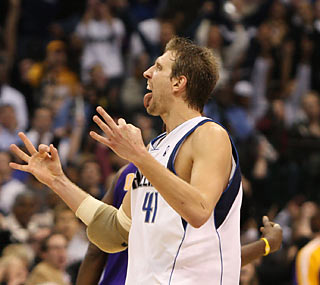 Dirk Nowitzki celebrates his achievement of joining the NBA's historic 20,000-point club.  (US Presswire)