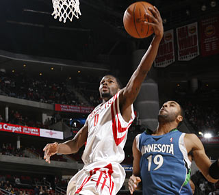 Aaron Brooks helps serve the Wolves a loss in their first 3OT game in franchise history.  (Getty Images)