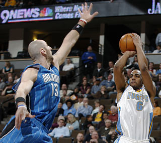 Marcin Gortat and the Magic are unable to put a stop to Arron Afflalo (13 points) and the Nuggets.  (AP)