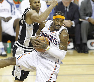 Whether it's flying for rebounds or dominating on D, Gerald Wallace makes his presence felt. (US Presswire)