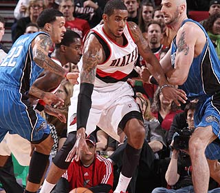 LaMarcus Aldridge is a challenge for the Magic as he finishes with 14 points and 14 boards. (Getty Images)