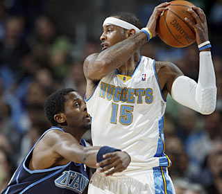 The Jazz have no answer for Carmelo Anthony, who goes for 37 points and eight rebounds.  (AP)