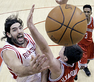 Luis Scola puts pressure on the Bucks all game, going for 27 points and 15 rebounds.  (AP)