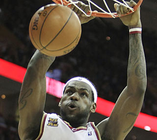 LeBron provides 28 points, 11 assists and nine boards as the Cavs open a long home stretch with a W.  (AP)
