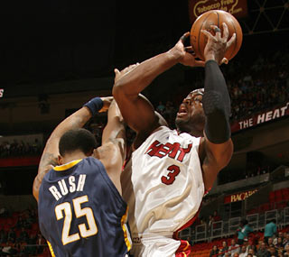 D-Wade, who begins 7-of-8 from the field, surpasses the 11,000-point career mark.  (Getty Images)