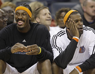 Gerald Wallace and Stephen Jackson enjoy the sideline view of Charlotte's clobbering of hapless Miami.  (AP)